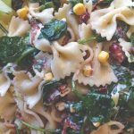 A mix of ribbon pasta, baby spinach, corn and bacon.